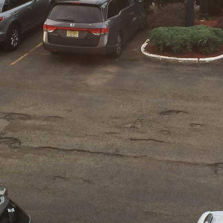 Bath, NY: pot holes in parking lot