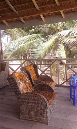 Central Region, Ghana:  View from the rooftop of orange beach bar and restaurant.With a comfortable couch chairs.