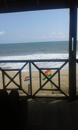 Central Region, Ghana: View from upstairs of orange beach bar and restaurant.