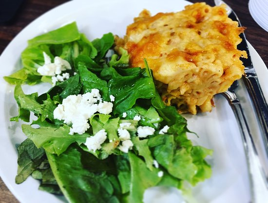 Liverpool, Kanada: Our mac and cheese with side local green salad and goat cheese
