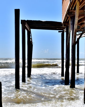 Surfside Beach, TX: House is completely torn up but still standing