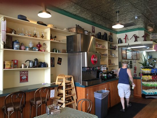 Erik's Deli Cafe: I had a lovely chicken wrap and gold star apple drink and then realised I was sitting In a verit