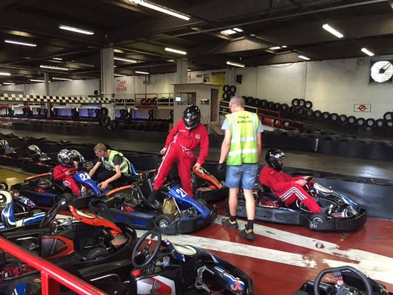 Corby, UK: Marshals showing them how karts work