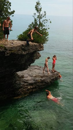 Sturgeon Bay, WI: My 8 year old, cliff jumping. (22 foot drop)