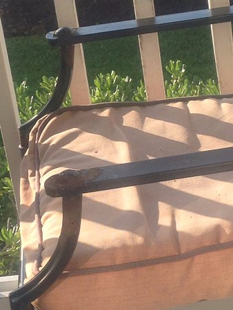 Pebble Beach Condominiums: rusted patio furniture and nasty cushions
