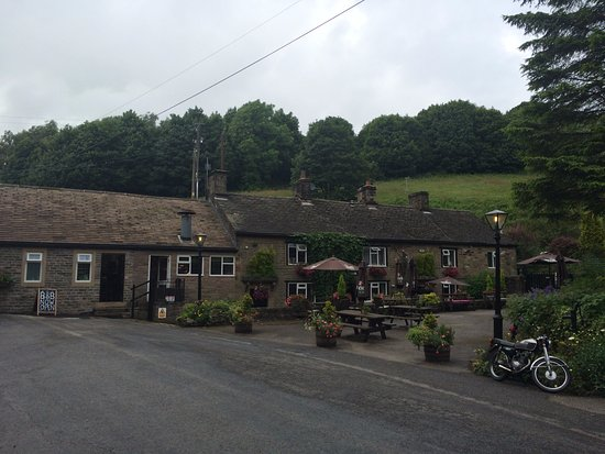 Chinley, UK: Parking lot shot - restaurant on the right.