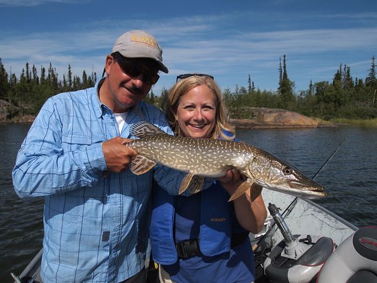 Yellowknife Outdoor Adventures: Cathie gets her fish with Carlos!
