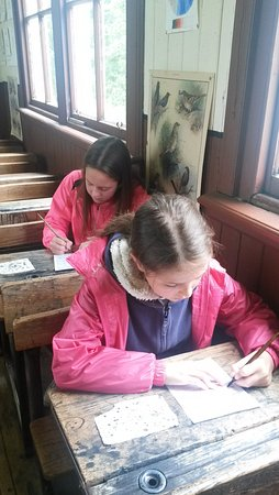 Highland Folk Museum: Practising handwriting in the old school with pens and ink.