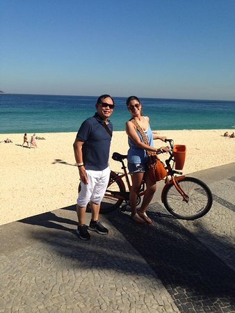 Atlantis Copacabana: At Copacana Beach with a Brazilian lady biking. Pose for a picture , very friendly.