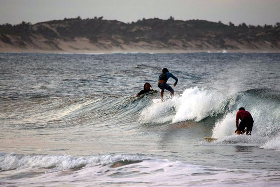 Surfers enjoying the waves at Tofo beach...