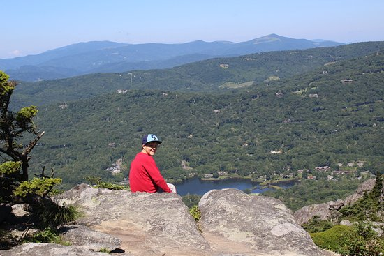 OurOur grandson sitting on one of the overlooks located near the top of Grandfather Mountain.
