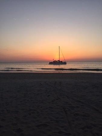 Couples Swept Away: Catamaran at sunset