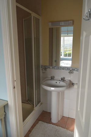 En Suite en suite bath showing shower toilet is in this photo