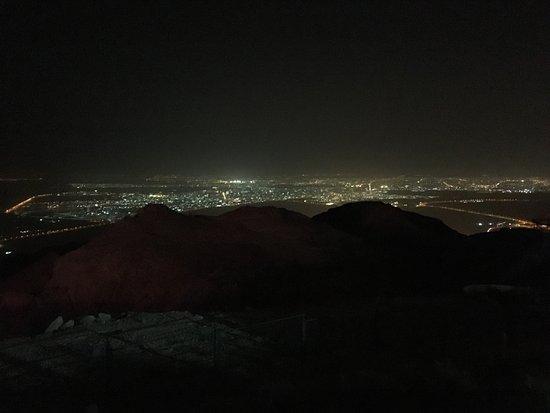 Mercure Grand Jebel Hafeet Al Ain: Al Ain at night through the haze