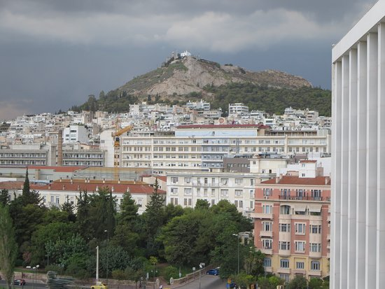 View of Mt Lycabettus from my balcony as storm clouds gather