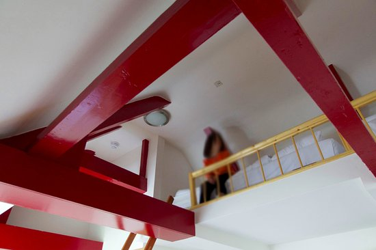 Amsterdam House Hotel: the loft in the family suite. the ladder (red) is seen just in the bottom of frame
