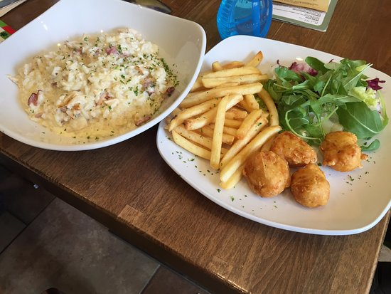 Street, UK: My chicken and bacon risotto beside my son's chicken nuggets and fries from the children's menu