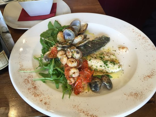 Street, UK: The sea bass main (Spigola on the menu) - a lot of fresh, good, tasty seafood on one plate