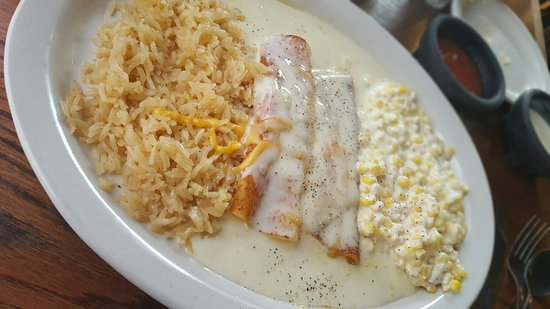 Cheese Enchiladas with white cheese queso, Mexican corn and rice.  So delicious.