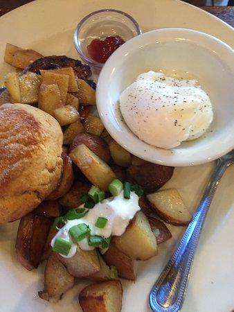 Venus Restaurant: Country breakfast, pork chop and apples, potatoes, poached eggs, and biscuit.