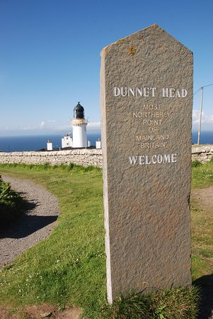 Thurso, UK: Dunnet Head Lighthouse and marker stone.