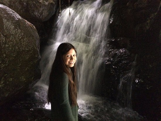 San Gerardo de Dota, Costa Rica : My daughter with the waterfall under the rock. It's like being inside a cave.
