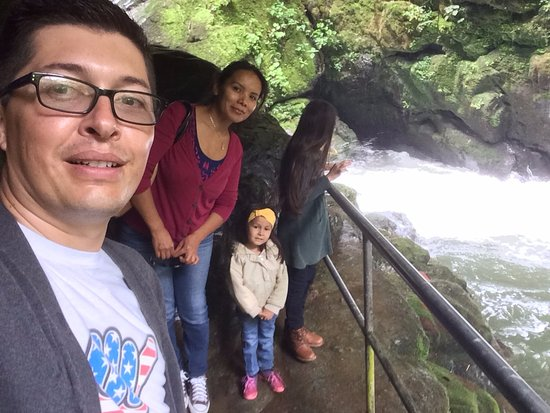 San Gerardo de Dota, Costa Rica : All four of us looks at the waterfall from the edge of the rock. They put up a handrail