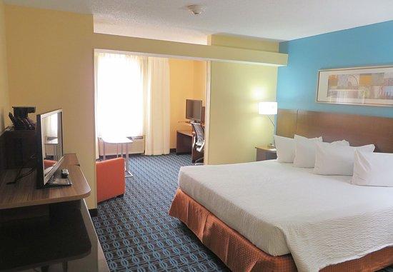Saint Charles, MO: King Suite Sleeping Area