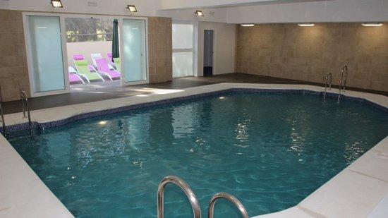 Apartamentos tur sticos interpass golf playa islantilla for Precio piscina climatizada
