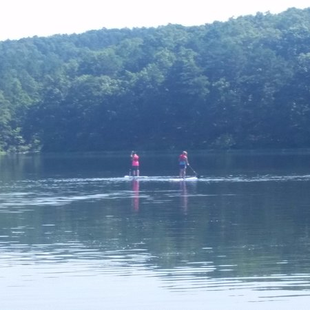 Potosi, MO: Two family members enjoy the free paddle boards.
