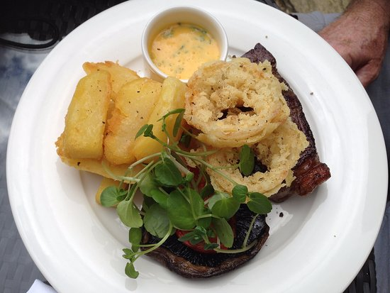 Shipton under Wychwood, UK: 8oz ribeye steak, mushrooms, onion rings, hand cut chips & bearnaise sauce