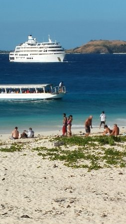 Denarau Island, Fiji: example of beach, glass bottom boat transfer to ship