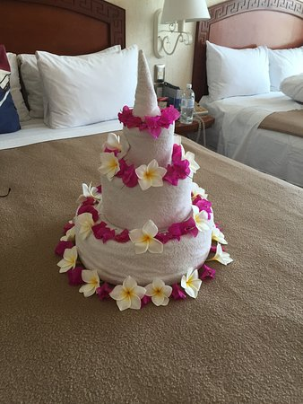 Hotel Posada Sian Kaan They Made A Cake With Fresh Flowers And Towels