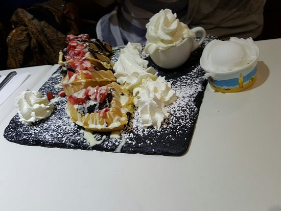 Southall, UK: Strawberry sensation waffle with whipped cream & lemon sorbet