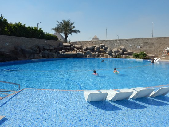 Le Meridien Pyramids Hotel & Spa: Hard to beat the water based lounge chairs while gazing at the great Pyramids!