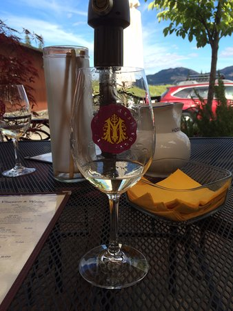 Hood River, OR: The Marchesi logo wine glass on the patio with the view in the distance