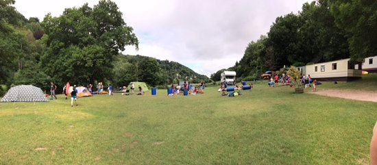 Symonds Yat East Campsite: Campsite with group of scouts preparing for rafting trip.