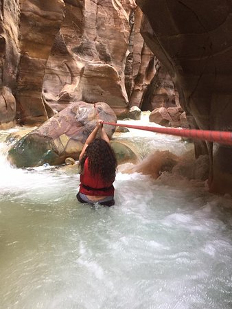 Wadi al-Mujib: Picture of crossing the river to get to a rock