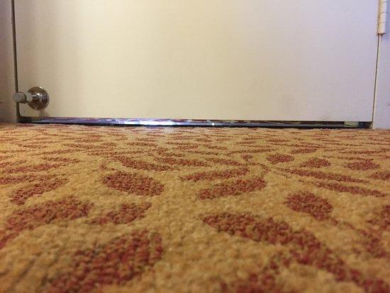 Oak Brook, IL: Gap under door = you hear everything in the hallway.