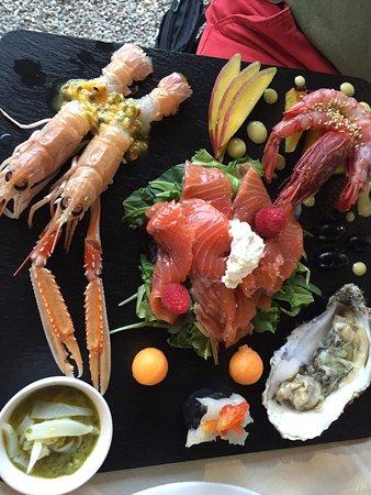 Monte Argentario, Italy: Crudo rivisitato. Scampi con Passion Fruit, gamberi rossi con nocciole, ostriche al lime, seppio