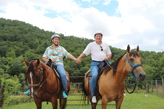 Appalachians Outdoor Adventures: Don with Indian Jones and Sandy with Sienna Sky on the trail.