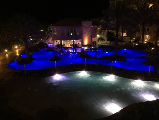 Divi Aruba Phoenix Beach Resort: Night view of the pool areas from 3rd floor balcony.