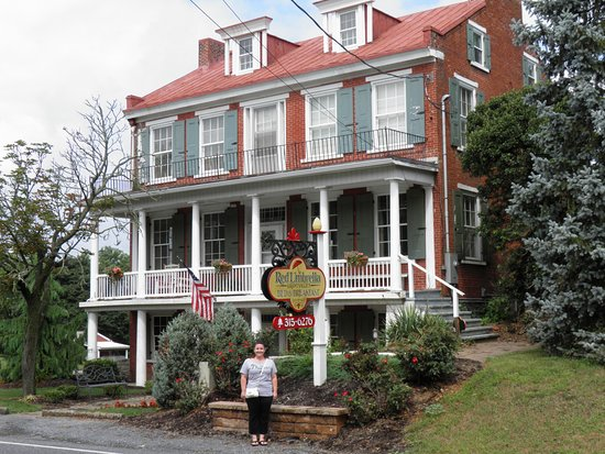 Red Umbrella Bed and Breakfast: This is my wife standing in front of the B & B.