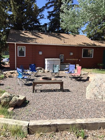 Colorado Cottages: Fire pit area stocked with wood, roasting sticks for marshmallows.
