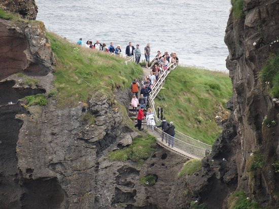 Ballintoy, UK: People wait to return while a group crosses from the mainland.