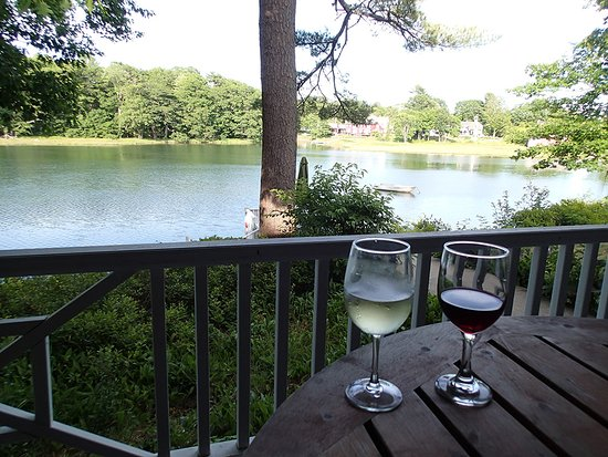 Bufflehead Cove Inn: glass of wine while sitting on the porch