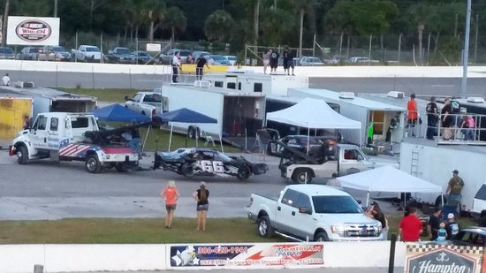 New Smyrna Speedway: Hauling a car off the track with a tow truck at each end.