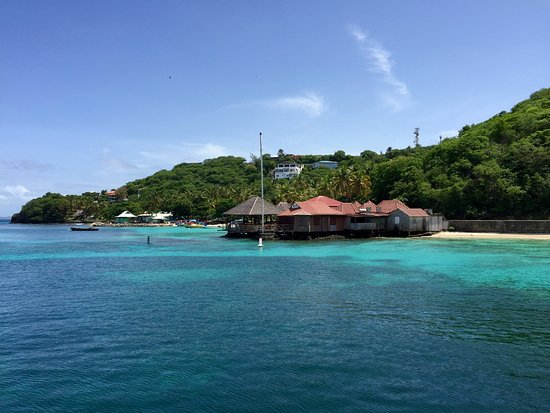 Mustique: Basil's over water restaurant and bar. Fish market farther up the beach.