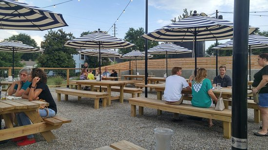 Finns Southern Kitchen: Nice Outdoor Patio. Large Wooden Picnic Tables And  Umbrellas. Bloody