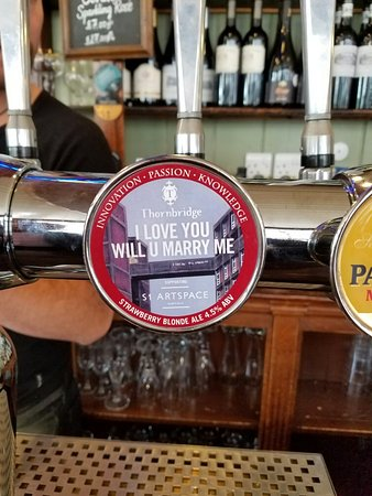 """A pint of """"I love you will you marry me"""" strawberry ale"""